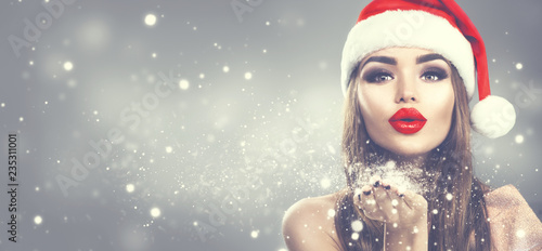 christmas winter fashion girl on holiday blurred winter background beautiful new year and xmas holiday