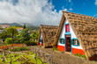 Leinwanddruck Bild - Traditional historic thatched houses with strawy roofs on Madeira island, Santana, Portugal