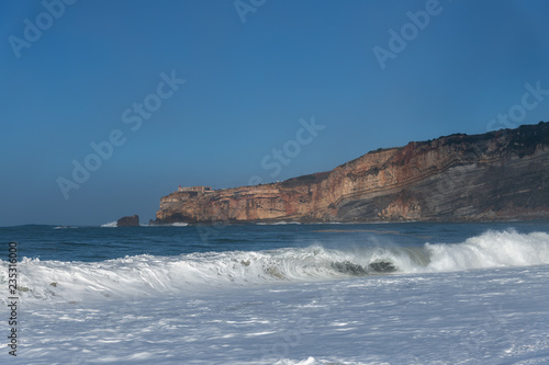 Atlantic ocean coast in morning time next to Nazare, Portugal.