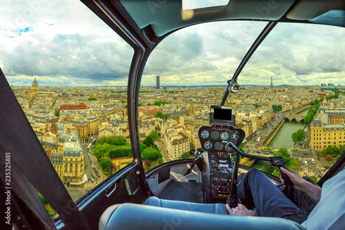 Obraz Helicopter cockpit flying on Notre Dame skyline of Paris, French capital, Europe. Scenic flight over Paris cityscape. - fototapety do salonu