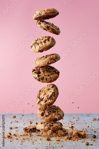 Chocolate chip cookies falling in stack