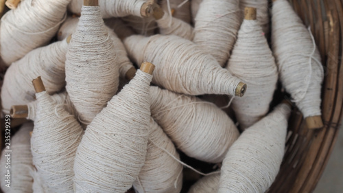 Fotografiet  Balls of cotton yarn in a basket, color natural dyes handmade, soft focus and vi
