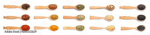 Fotografie, Obraz  Wooden spoons with different spices and herbs on white background