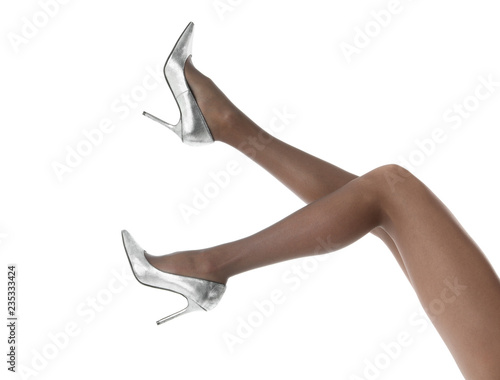 ec4a55431 Legs of beautiful young woman in tights and high-heeled shoes on white  background