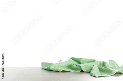 Crumpled napkin on table against white background