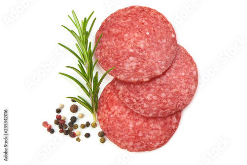 Valokuva Dried Salami Sausage Slices with rosemary and peppercorns, isolated on a white background