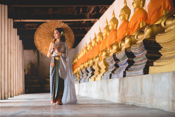 Thailand or Thai costume Asian dress concept. Young Thai beautiful woman  are walking in the Buddhist temple in Ayutthaya