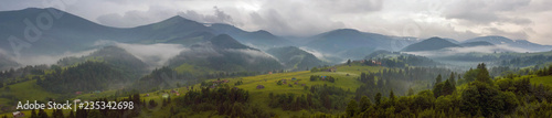 Fototapeta Fantastically beautiful morning in the Carpathians in the summer. amazing view of the mountain village Dzembronya foggy morning in the mountains in summer. obraz na płótnie