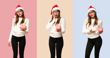 Set Of Girl With Celebrating The Christmas Holidays Surprised While Holding A Big Piggybank