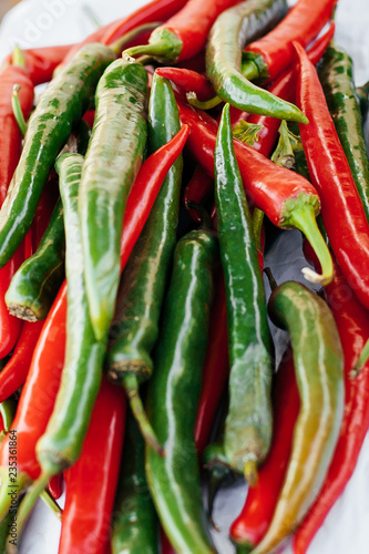 Fototapety, obrazy: heap of red and green hot chilli peppers close up. color contrast