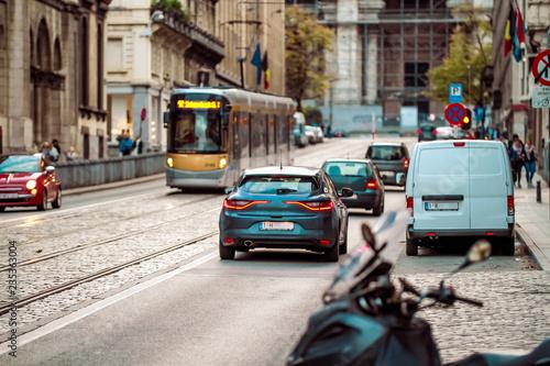 Poster de jardin Havana Brussels, Kingdom of Belgium. Tram and few cars on the street. Sunset. Belgian road.