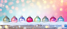 Colorful Baubles On Snow In Sh...