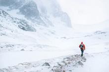 Climber Walks Alone In High Mo...