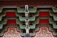 Wooden Roof Decoration And Traditional Exterior Architecture Of A Main Temple In Downtown Taichung, Taiwan, Asia