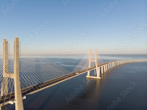 Vasco da Gama Bridge landscape at sunrise Wallpaper Mural