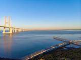 Vasco da Gama Bridge landscape at sunrise. One of the longest bridges in the world. Lisbon is an amazing tourist destination because its light, its monuments. Portugal landmark.