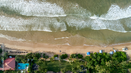 Aerial flying drone view of indian ocean on sunny tropical paradise island with aqua blue sea water