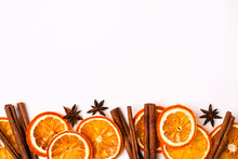 Christmas Nature Border Of Dry Oranges Slices And Cinnamon Sticks