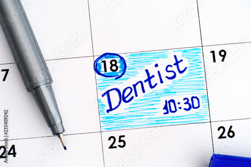 Reminder Dentist In Calendar With Blue Pen Buy This Stock Photo