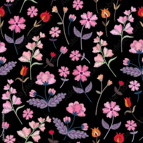 Türaufkleber Künstlich Embroidery seamless pattern with different wild flowers. Vector floral ornament on black background. Satin stitch.