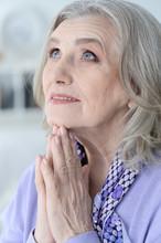 Close Up Portrait Of Beautiful Senior Woman Praying