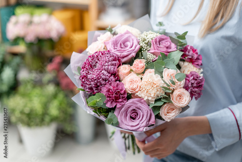 European floral shop. Bouquet of beautiful Mixed flowers in woman hand. Excellent garden flowers in the arrangement , the work of a professional florist. © malkovkosta