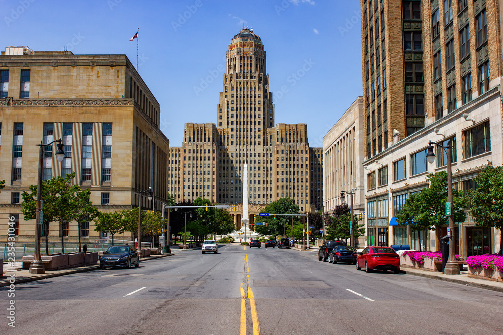 Fototapety, obrazy: Buffalo City hall and Niagara Square ( State of New York) view from court Street during day time from the middle of the road. Blue sky with almost no clouds and no cars driving by.