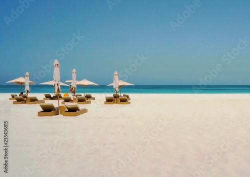 Poster Abou Dabi Beautiful beach with an umbrella on the shore of the Arabian Gulf. Dubai.