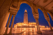 Leinwanddruck Bild - The Hassan II Mosque at the night in Casablanca, Morocco. Hassan II Mosque is the largest mosque in Morocco and one of the most beautiful. the 13th largest in the world. Shot after sunset at blue hour