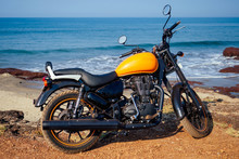 Motorcycle Royal Enfield On A Background Of Tropical Paradise Sea And Rock.travel And Entertainment In The Asian Country Concept