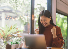 Young Asian Woman Celebrate Success Or Happy Pose With Laptop