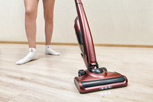 Cleaning Lady Vacuums With  Up...