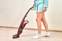 Cleaning Woman In Bathrobe Vacuums With Portable Vacuum Cleaner.