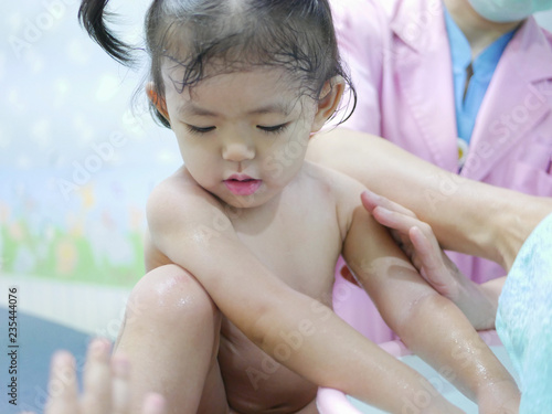 Little Asian baby girl, 20 months old, having a fever, getting a