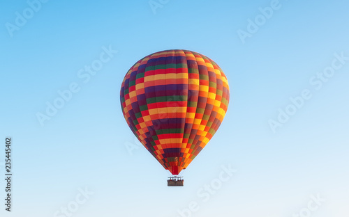 Airballoon in Turkey, Cappadocia. Travel and leisure. Adventure in the air. Concept and idea of adventure. Airballoon on the sky background