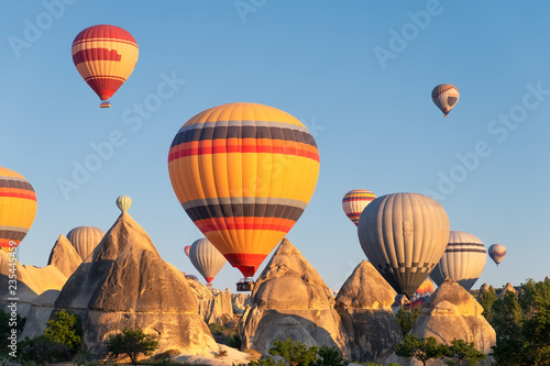 Airballoons in Turkey, Cappadocia. Travel and leisure. Adventure in the air. Concept and idea of adventure. Airballoons on the sky background