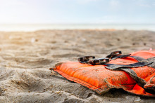 Close Up Of Life Jacket On The Beach In Sunrise, Selective Focus.