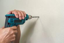 Asian Man Use Electric Drill O...