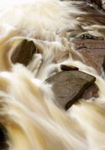 WATER RUSHING OVER ROCKS AT BRACKLINN FALLS STIRLING SCOTLAND