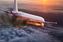 Airplane With Engine On Fire, Concept Of Aerial Disaster.