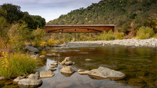 Side View Of The Bridgeport Covered Bridge At South Yuba River In California, USA, In The Autumn. This Bridge Has The Longest Clear Span Of Any Surviving Covered Bridge In The World