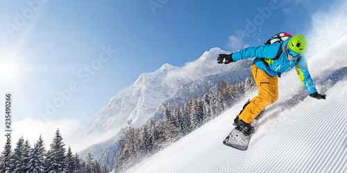 plakat Man snowboarder riding on slope.