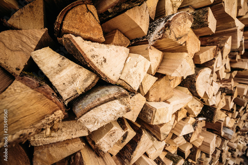 Photo Stands Firewood texture Wooden firewood stacked in a wall
