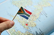 canvas print picture - South Africans living in the United Kingdom (UK) concept image consisting of a flag and map. This image can also be used to represent Emigration.