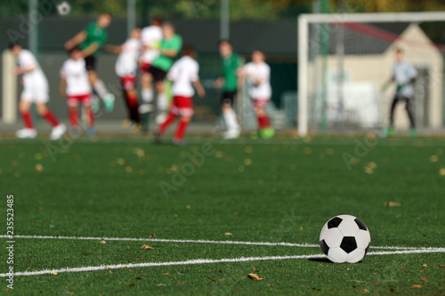 Fotografia  Young boys playing a football match and empty space for text