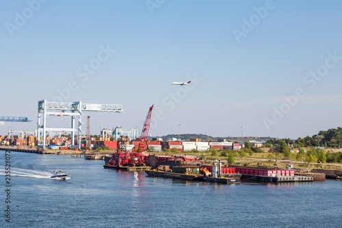 Photo  Boats and Plane Near Portland Industry