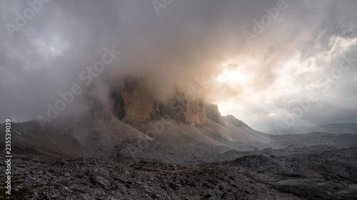 Fotografie, Obraz  Tre Cime di Lavaredo mountain inside the clouds in sunset.