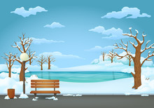 Winter Day In The Park. Wooden Bench With Trash Can And Street Lamp On An Asphalt Trail With Frozen Lake On The Background.