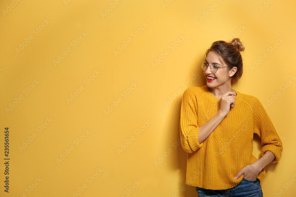 Fototapety, obrazy: Beautiful young woman in warm sweater on color background. Space for text