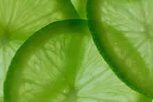 Macro Of Fresh Lime Slices With Backlight; Gives Feeling Of Freshness; Juicy Pieces Of Fruit And Bright Green Colour
